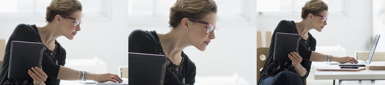 Bild Facts & Figures. Iventa Mitarbeiterin hält Tablet und blickt auf ihren Laptop